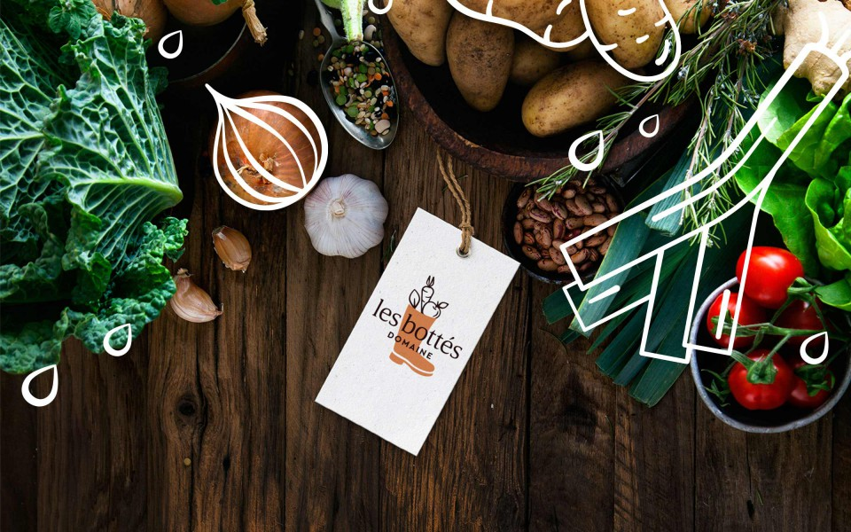 Banner principale de la page des Bottés avec légumes et logo